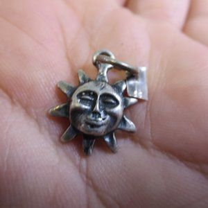 Vintage Sterling Man in the Sun Pendant